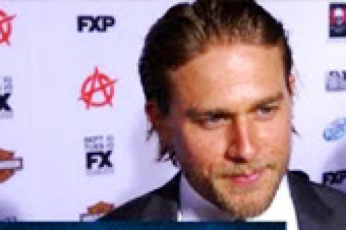 charlie hunnam talks christian grey